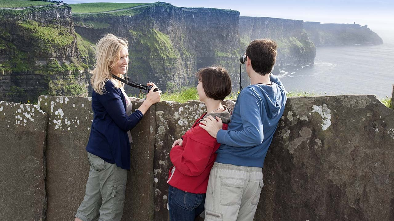 People on a cliff overlook in Ireland.