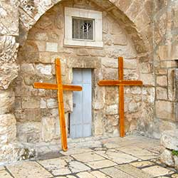 Two crosses outside of the Holy Sepulchre.