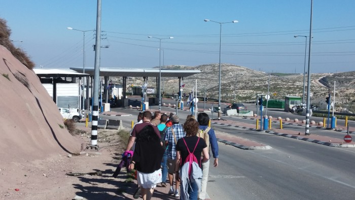 Tour of the Separation Wall and observing a checkpoint in East Jerusalem