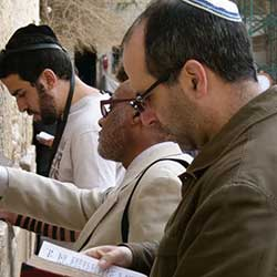 People praying at Western Wall.