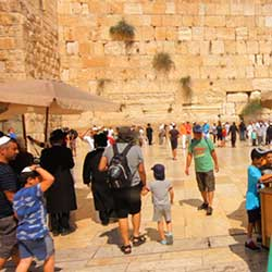 People visiting the Western Wall.
