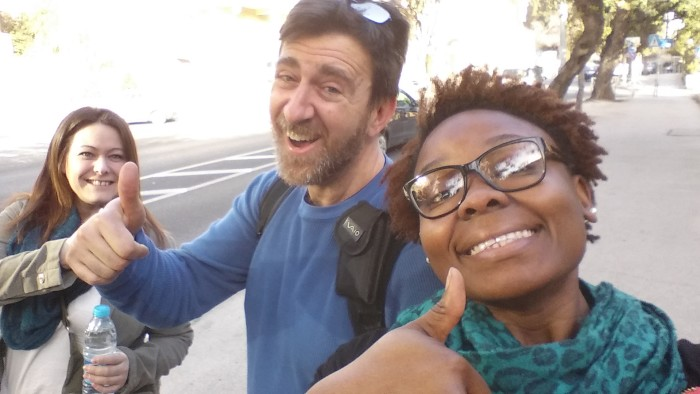 Students teaching Professor Telman how to take a selfie!