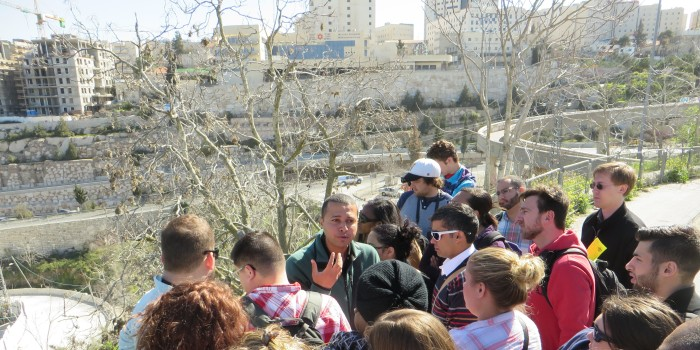 Guide Ala'a discussing history prior to their exploration of Lifta.